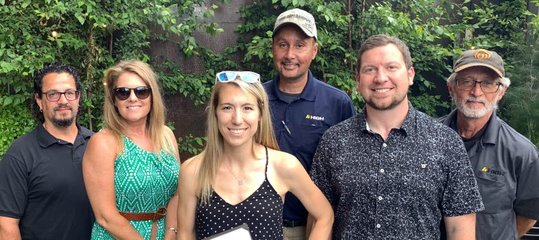 Five High co-workers from Orchard Ridge Apartments smile for the camera.