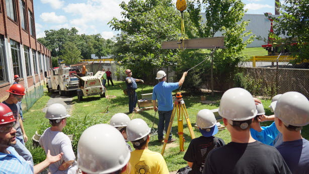 Students learn first-hand how bridge girders are installed.